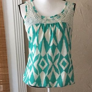 Lace trimmed top.  Size M